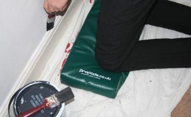 propads green knee mat with decorator kneeling